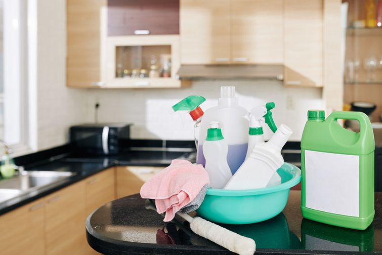 Bottles of DIY disinfectant spray on kitchen island in Mississaauga home